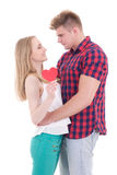 First love concept - young man and woman holding heart isolated Stock Image