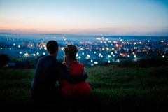 The first love. Lovers against the background of a night city, night starry sky and horizon. Concept is a romantic date, the first love royalty free stock photo