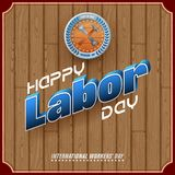 First May, Labor day, international celebration. Holidays, design background with 3d texts, hammer and wrench on wood texture for celebration of First May Stock Photos