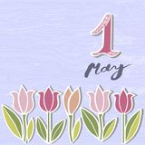 First of May text isolated on background with flowers. Template for International Labor Day, invitation, greeting card, web, postcard Royalty Free Stock Image