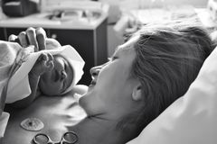 The first moments of mother and newborn after childbirth stock images