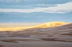 Great Sand Dunes National Park at dawn. First morning light over Great Sand Dunes National Park and San Louis Valley in Colorado Stock Image
