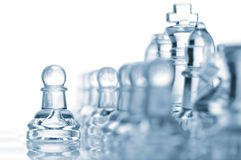 First move. Of a glass pawn Royalty Free Stock Images