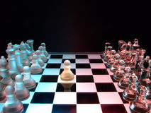 The First Move. A glass chess set showing an opening move with king's pawn Stock Photo
