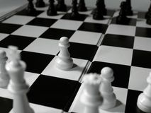 First move. Black and white chessboard with focus on one piece Stock Photos