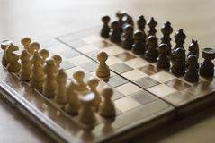 First move of chess game. One pawn on middle of board Stock Photos