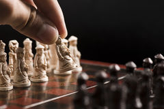 First move of a chess game. Making the first move of a chess game Royalty Free Stock Photography
