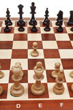 First move pawn on chessboard Royalty Free Stock Images