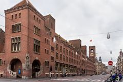 AMSTERDAM, NETHERLANDS - JUNE 25, 2017: View to the Beurs van Berlage building. It first opened as a commodity exchange in 1903, is now used primarily as a Stock Photo