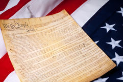 The first page of the US Constitution. Of the American flag Royalty Free Stock Photography