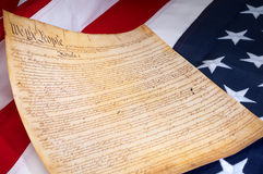 The first page of the US Constitution. Of the American flag Stock Photos