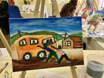 Art Class After. First painting completed at an art class royalty free stock image