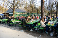 The first patrons enjoy a beer at a beergarden. In the Englischer Garten on a sunny spring afternoon Stock Images