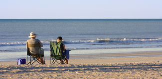 The first pension. Couple relax at a lonely beach Royalty Free Stock Image