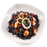 First person perspective of Arroz Negro dish Royalty Free Stock Images