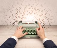 First person perspective elegant hand typing with flying letters concept Royalty Free Stock Images