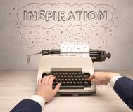 First person perspective hand and typewriter with cloud message concept. First person perspective hand writing on typewriter with cloud message concept Royalty Free Stock Photos