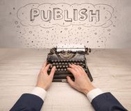 First person perspective hand and typewriter with cloud message concept Royalty Free Stock Image