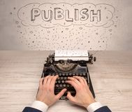 First person perspective hand and typewriter with cloud message concept. First person perspective hand writing on typewriter with cloud message conceptn Royalty Free Stock Photos