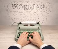First person perspective hand and typewriter with cloud message concept. First person perspective hand writing on typewriter with cloud message conceptn Royalty Free Stock Images