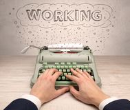 First person perspective hand and typewriter with cloud message concept. First person perspective hand writing on typewriter with cloud message conceptn Stock Photos
