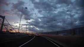 First person pov on gorgeous view from wind shield glass on heavy gray rain cloud in sky over busy traffic highway road. First person pov on gorgeous view from stock footage