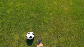 First-person view of an athlete with a bionic leg dribbling a ball. 4K stock footage