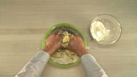 First-person view of chef kneads dough stock footage