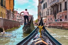 First person view from a gondola in Venice royalty free stock photo