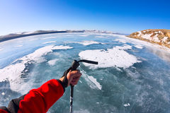 First person view gopro stick in his hand on the ice of Lake Bai Royalty Free Stock Image