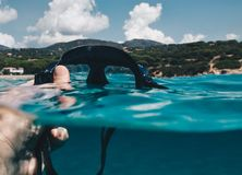 First person view Half underwater view of Man taking off Diving mask for scuba diving.  stock images