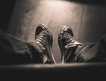 First-person view on retro sneakers - black and white royalty free stock images