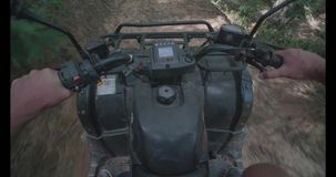 First person view riding on quad bike, ATV. In the tropical forest stock video footage
