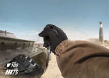 First person view soldier arm holding tactical knife. Royalty Free Stock Photo