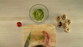 First person view to prepare stuffing mushrooms stock video