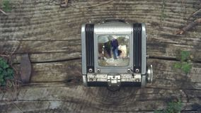 First person view through vintage TLR Twin lens reflex camera viewfinder. Old vintage film camera. The camera on a