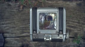 First person view through vintage TLR Twin lens reflex camera viewfinder. Old vintage film camera. The camera on a. Vintage background. Focus on the image, the stock footage
