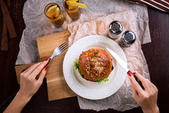 First person view of a woman preparing eat burger. Stock Images