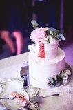First piese of white wedding cake with flowers Royalty Free Stock Photos