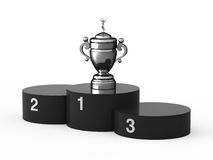 First place. Black podium and silver cup Royalty Free Stock Photography