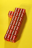 First place. The number one made out of red dices on yellow background Royalty Free Stock Photo