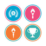First place award cup icons. Prize for winner. First place award cup icons. Laurel wreath sign. Torch fire flame symbol. Prize for winner. Colored circle Royalty Free Stock Images