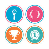 First place award cup icons. Prize for winner. First place award cup icons. Laurel wreath sign. Torch fire flame symbol. Prize for winner. Colored circle Stock Image