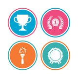 First place award cup icons. Prize for winner. First place award cup icons. Laurel wreath sign. Torch fire flame symbol. Prize for winner. Colored circle Stock Photo