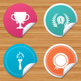 First place award cup icons. Prize for winner. Round stickers or website banners. First place award cup icons. Laurel wreath sign. Torch fire flame symbol Stock Image