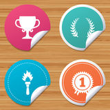 First place award cup icons. Prize for winner. Round stickers or website banners. First place award cup icons. Laurel wreath sign. Torch fire flame symbol Stock Images
