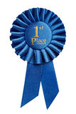 First place award. Rosette isolated on white background Stock Photo