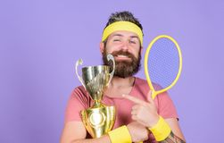 First place. Sport achievement. Tennis champion. Win tennis game. Celebrate victory. Athletic man hold tennis racket and. Golden goblet. Tennis player win stock photos