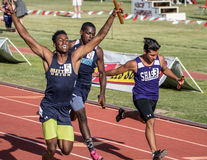 First Place. A sprinter comes in first after winning the 4x100   during  section finals in northern California on  May 29, 2015 Stock Photo