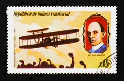 First public flight in France 1908 and W. Wright portrait, circa 1979. MOSCOW, RUSSIA - AUGUST 29, 2017: A stamp printed in Equatorial Guinea shows First public Stock Photography